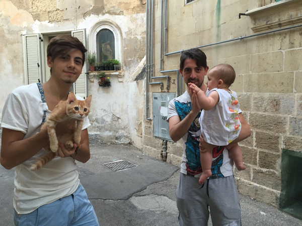 Brothers and their babies, Lecce, Italy
