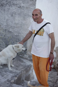 The Gentleman with Nine Cats and a White Dog, Matera, Italy